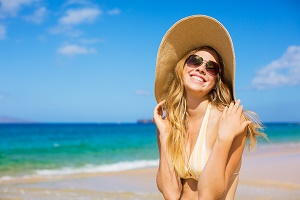 woman on beach in hat