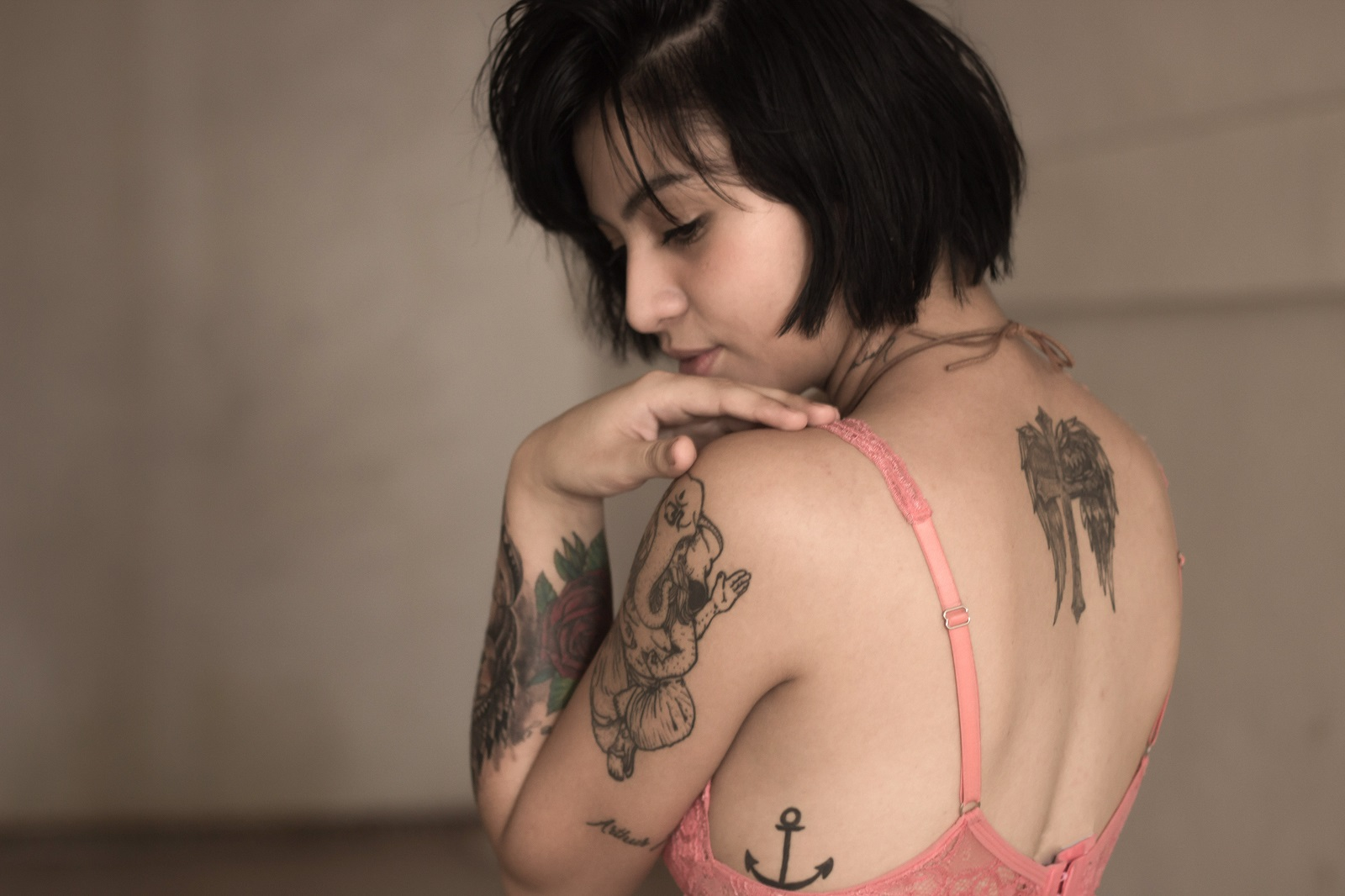 woman with tattoos in a bra