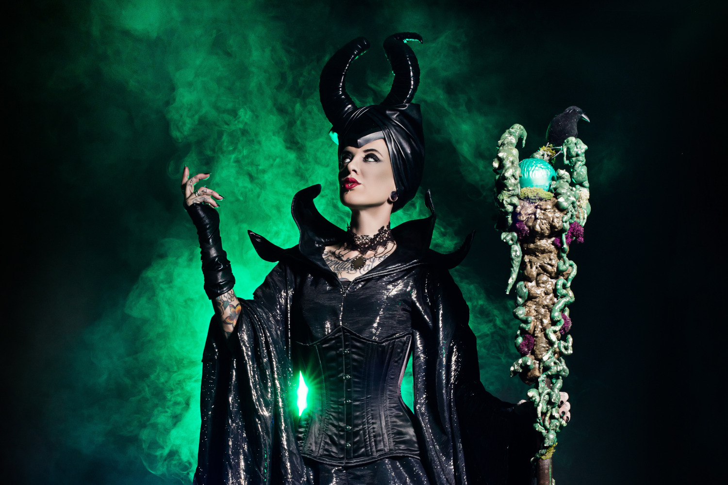 Woman wearing Maleficent costume.