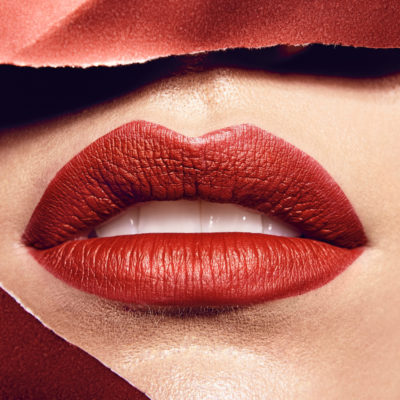 Close up woman's lips with red lipstick.