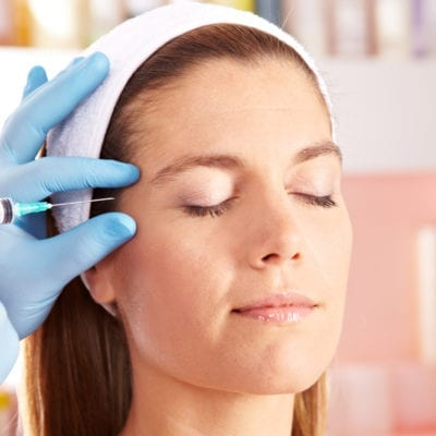 Woman getting Botox for depression